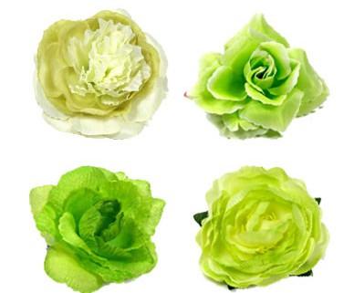 Ansteckblumen und Haarrosen in den Farben mint und grün